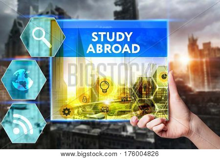 Technology, Internet, Business And Marketing. Young Business Woman Writing Word: Study Abroad
