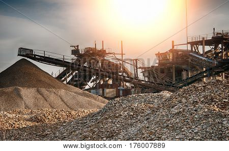 conveyors in a stone quarry at sunset