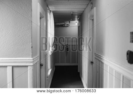 Hallway leading down to a fire extinguisher inside building
