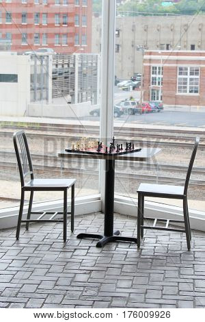 Metal chairs near a window