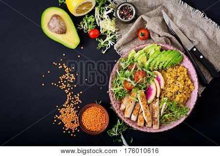 Healthy Salad With Chicken, Tomatoes,  Avocado, Lettuce, Watermelon Radish And Lentil On Dark Backgr