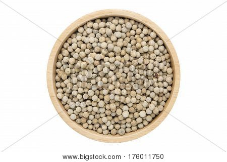 White peppercorns in wooden bowl isolated top view on white with clipping path
