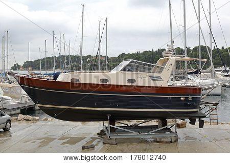 ROVINJ CROATIA - OCTOBER 15: Apreamare 10 Yach at Dock in Rovinj on OCTOBER 15 2014. Motor Boat Out of Water For Winter in Rovinj Croatia.