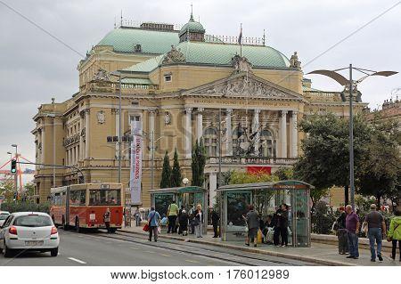 RIJEKA CROATIA - OCTOBER 17: National Theatre Ivan Zajc in Rijeka on OCTOBER 17 2014. Croatian and Italian Drama Opera and Ballet Activity in Classics Style Building in Rijeka Croatia.