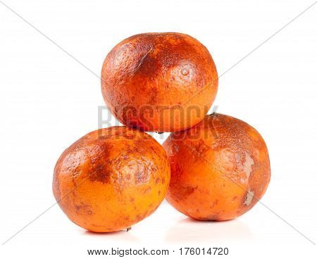 three damaged tangerine isolated on white background.