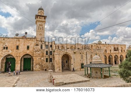 JERUSALEM, ISRAEL - MAY 23, 2016: Tourists visiting the Dome of the Rock and Bab el Ghawanimeh Mosque, an Islamic shrine located on the Temple Mount in the Old City.