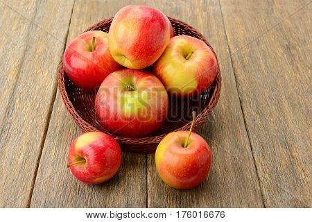 group red apples on a wooden surface