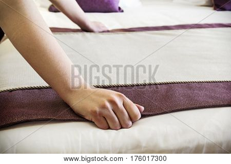 female hands corrected blanket on the bed