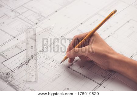 Architectural design and project blueprints drawings. digital tablet with architectural blueprints rolls and tools.