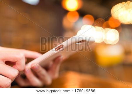 Woman use on mobile phone with bokeh background
