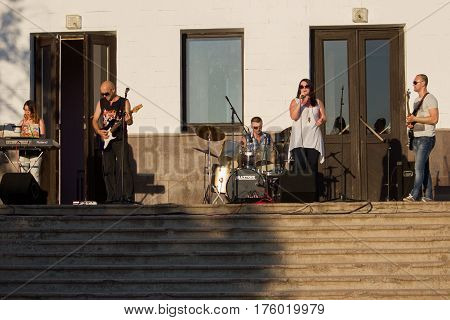 MARGANETS, UKRAINE - JUNE 26, 2016: Young unknown rock band giving expressive concert on National Youth Day