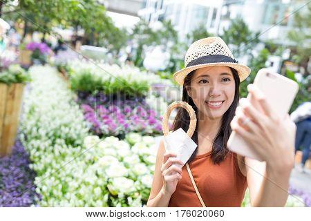 Woman taking selfie with her Spanish churro