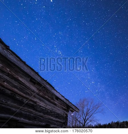 Rural Log Cabin Barn At Night With Stars And Milky Way