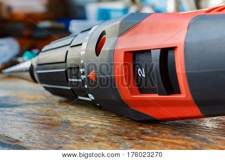 Red screwdriver on a wooden table closeup