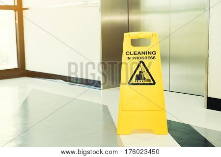 cleaning progress caution sign in office, close up