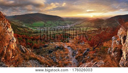 Panorama of Colorful autumn landscape in the mountain village. Foggy morning in the Carpathian mountains.