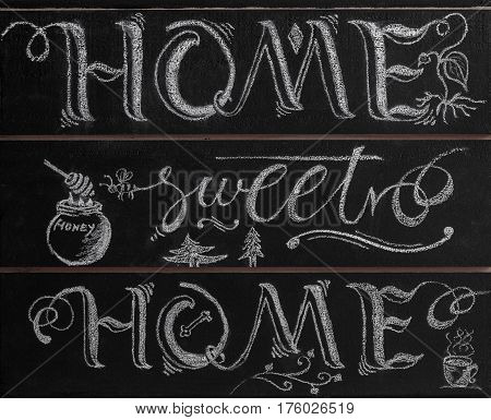 Hand lettering calligraphy sign drawn with chalk. Lettered quote 'Home sweet home'