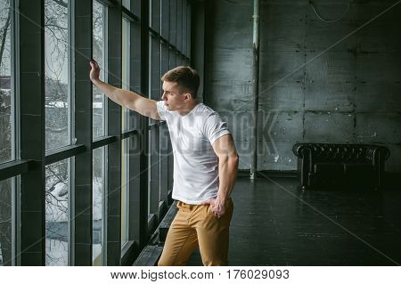 Young Sexy Men Bodybuilder Athlete,studio Portrait In Loft On The Background Of Stylized Wall And Bl