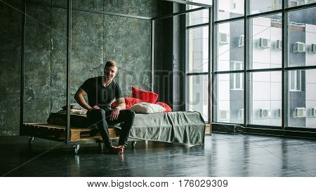 Young Sexy Men Bodybuilder Athlete,studio Portrait Loft On Background Of Stylized Wall,guy Model Bla