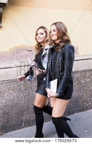 MILAN ITALY - FEBRUARY 25: Fashionable women pose outside Blumarine fashion show during Milan Women's Fashion Week on FEBRUARY 25 2017 in Milan.