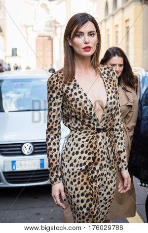 MILAN ITALY - FEBRUARY 25: Fashionable woman poses outside Blumarine fashion show during Milan Women's Fashion Week on FEBRUARY 25 2017 in Milan.