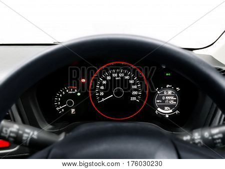 Car steering wheel and dashboard over white