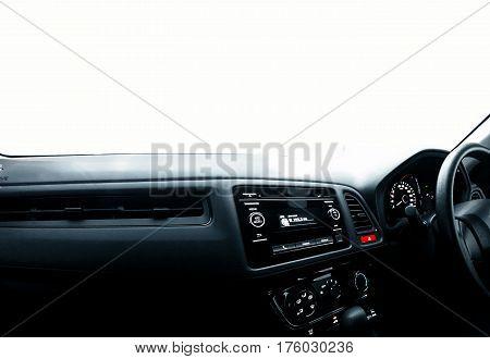 Car dashboard in wide angle over white windscreen