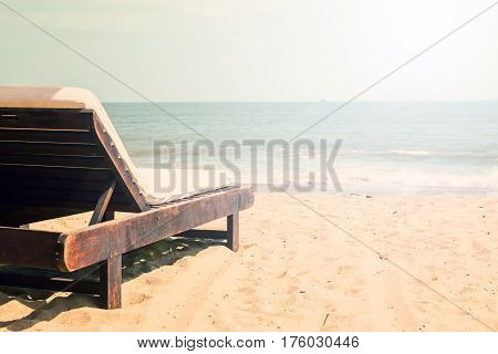 Beautiful beach with chaise lounge. Sea background with copy space. tonned