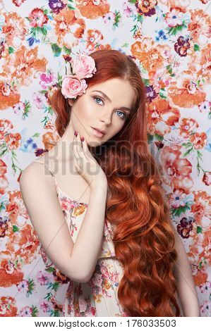 Sexy beautiful redhead girl with long hair. Perfect woman portrait with a colored light background. Gorgeous hair and deep eyes. Natural beauty clean skin facial care and hair. Strong and thick hair