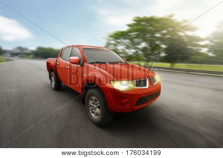 Red Four Door Pickup Truck With High Speed