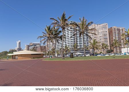 Empty  Paved Promenade On Beachfront Against City Skyline