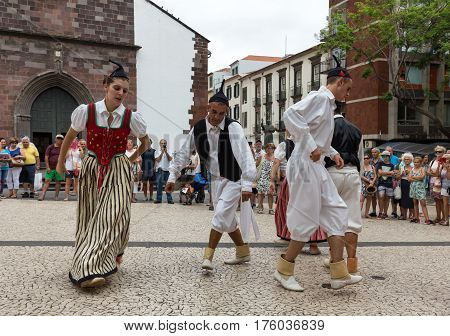 FUNCHAL PORTUGAL - SEPTEMBER 2 2016: Dancers with local costumes demonstrating a folk dance during the Wine Festival in Funchal on the Madeira Portugal.