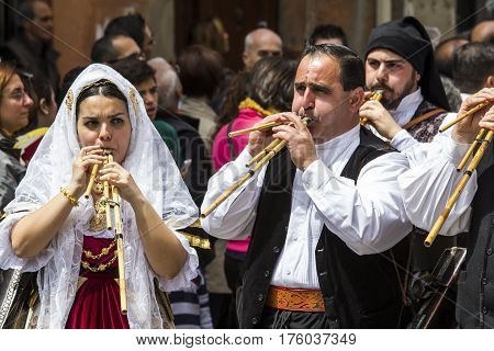 CAGLIARI, ITALY - May 1, 2014: 358 ^ Religious Procession of Sant'Efisio - launeddas musicians parading in traditional Sardinian costume - Sardinia