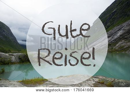 German Text Gute Reise Means Good Trip. Lake With Mountains In Norway. Cloudy Sky. Peaceful Scenery, Landscape With Rocks And Grass. Greeting Card