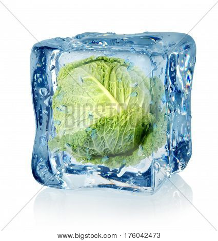 Ice cube and savoy cabbage isolated on a white background