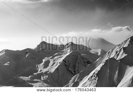 Black And White View On Snowy Sunlight Mountains In Early Fog Morning