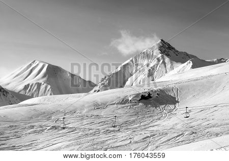 Black And White View On Ski Slope At Winter Evening