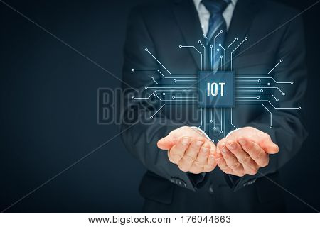 Internet of things (IoT) concept. Businessman offer IoT products and solutions. Abstract chip with text IoT connected with abstract devices represented by points. poster