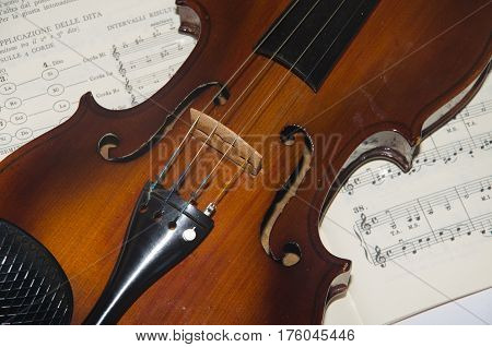 Study music: detail of old violin and notes