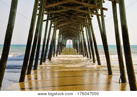 Looking underneath the pier at the water