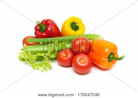 Sweet pepper celery and tomatoes on a white background. Horizontal photo.