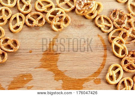 Pretzels traditional german Oktoberfest snacks and beer trace drops concept
