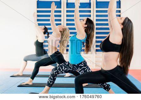 Women In Warrior 1 Pose