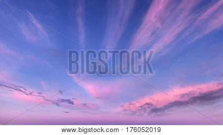 Soft fluffy and colorful cloud formation as background taken at dawn.