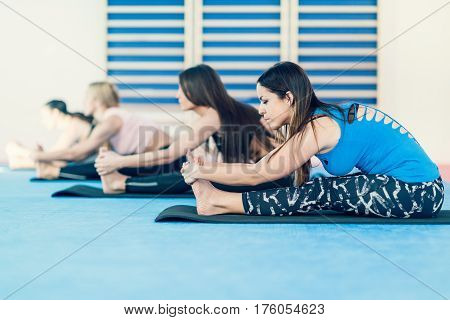Women in west side pose on yoga class