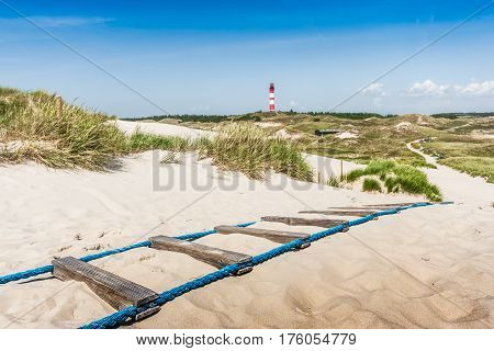 Beautiful dune landscape with traditional lighthouse on the island of Amrum at North Sea Schleswig-Holstein Germany