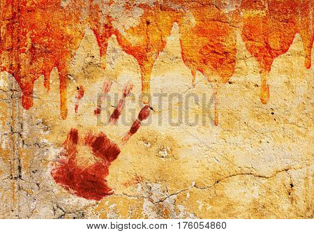 Halloween background. Blood and print of human palm on stucco wall