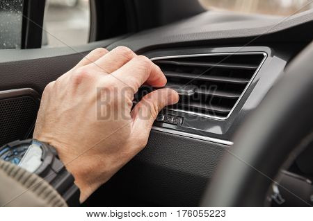 Driver Hand On Air Ventilation Grille