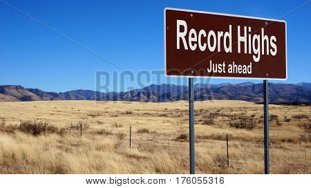Record Highs road sign with blue sky and wilderness
