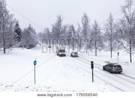 UMEA, SWEDEN ON MARCH 02.View of a modern street, road and the traffic in snowy condition on March 02, 2017 in Umea, Sweden. Editorial use.